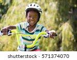 A Sporty Kid Bike Riding On A...