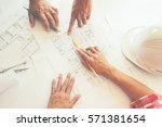 hands of engineer working on... | Shutterstock . vector #571381654