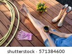 woman with cup of coffee and... | Shutterstock . vector #571384600