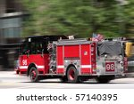 Red Fire Truck Rushing Down Th...