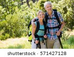 senior couple standing with... | Shutterstock . vector #571427128