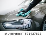 a man cleaning car with... | Shutterstock . vector #571427833