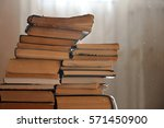 stack of old yellowed books  in ... | Shutterstock . vector #571450900