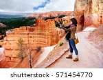young female tourist making... | Shutterstock . vector #571454770