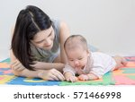 mother playing with a little... | Shutterstock . vector #571466998