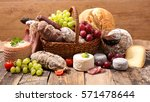 cheese meats and wine | Shutterstock . vector #571478644