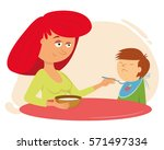 family dinner. mother feeds the ... | Shutterstock .eps vector #571497334