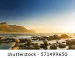 ocean rock pools at sunset in... | Shutterstock . vector #571499650