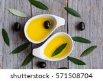 olive oil with olive leaves on... | Shutterstock . vector #571508704