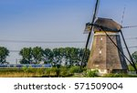 Windmill And Train In Holland