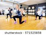 smiling team do split squats... | Shutterstock . vector #571525858