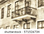 Small photo of Plastered building facade in evening light with many windows and a beautifully adorned smithery balcony, textured in sepia tones from the right angle in old fashion style.