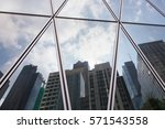 reflection office building over ... | Shutterstock . vector #571543558