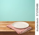 empty white plate on wooden... | Shutterstock . vector #571550488