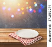 empty white plate on wooden... | Shutterstock . vector #571551274