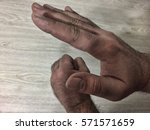 Small photo of Man hands. Gestures swearword in Arabic countries