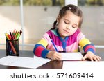 Little Girl Is Drawing Picture - stock photo