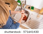 high angle view of woman using... | Shutterstock . vector #571641430