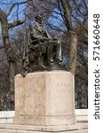 Small photo of Abraham Lincoln statue in Grant Park on a sunny early Spring day. Chicago, Illinois, USA.