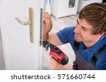 smiling young carpenter install ... | Shutterstock . vector #571660744
