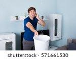worried man calling plumber... | Shutterstock . vector #571661530