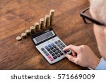 person hand doing calculation... | Shutterstock . vector #571669009