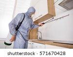 pest control worker in workwear ... | Shutterstock . vector #571670428