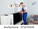 male technician checking... | Shutterstock . vector #571670440