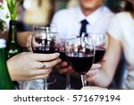glasses of red wine. the... | Shutterstock . vector #571679194