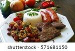 detail of brazilian food dish | Shutterstock . vector #571681150