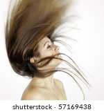 young lady with flowing hair - stock photo
