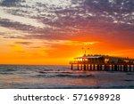 sunset over the pier  of lido... | Shutterstock . vector #571698928