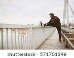 young man in sportswear. guy...   Shutterstock . vector #571701346