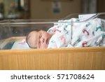 newborn baby in hospital after...   Shutterstock . vector #571708624