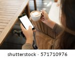 woman holding phone and coffee... | Shutterstock . vector #571710976
