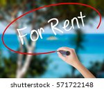 Small photo of Woman Hand Writing For Rent with black marker on visual screen. Isolated on nature. Business concept. Stock Photo