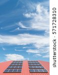 Solar Panel On Red Roof Tile...