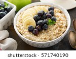 steel cut oatmeal porridge with ... | Shutterstock . vector #571740190