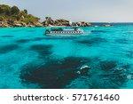 tourist diving boat near island ... | Shutterstock . vector #571761460