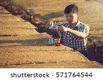 farmer researching plant in...   Shutterstock . vector #571764544