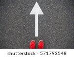 sneakers on the asphalt road... | Shutterstock . vector #571793548