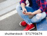 young hipster girl sitting at... | Shutterstock . vector #571793674