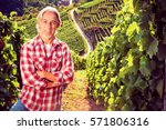 winemaker standing by his... | Shutterstock . vector #571806316