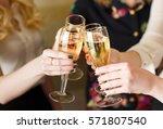 hands holding the glasses of... | Shutterstock . vector #571807540