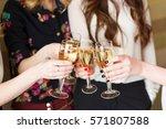 hands holding the glasses of... | Shutterstock . vector #571807588