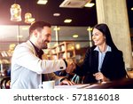 business people at cafe making... | Shutterstock . vector #571816018