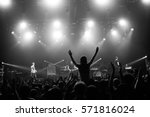 girl silhouette in a crowd on... | Shutterstock . vector #571816024