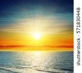 Orange Sunset In Clouds Over Sea