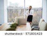 business woman speak phone in... | Shutterstock . vector #571831423
