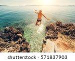 Man Jumps In Blue Sea Lagoon...